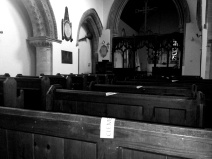 The pew at the front of the image has been reserved for the Clements.