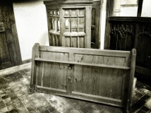 Resting against the pulpit