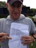 Pete holding The Stomp running order.