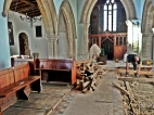 The floor under the victorian pews is removed.