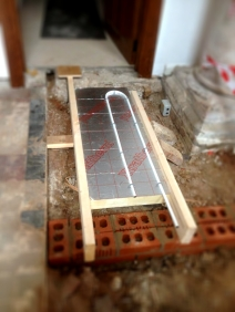 A mock up of the underfloor heating and floor sample.