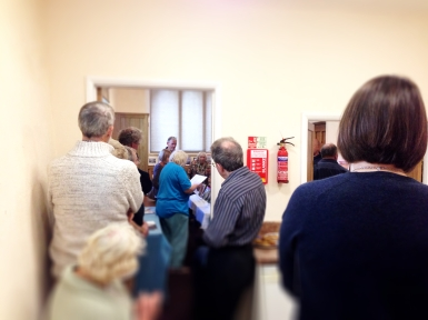 The overspill into the kitchen as Mo reads out the winners chosen by the photography department at the Newark Advertiser.
