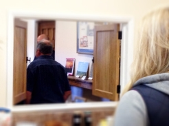 Using every vantage point - Rachel Clements looking through the kitchen hatch.