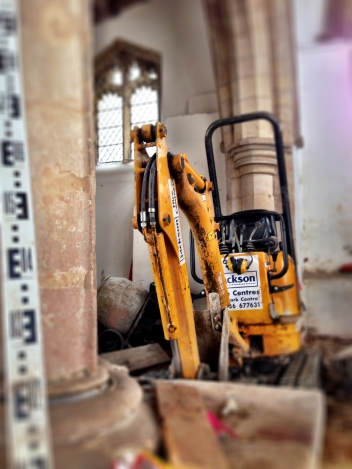 Mini-digger in a church. It's remains surreal.