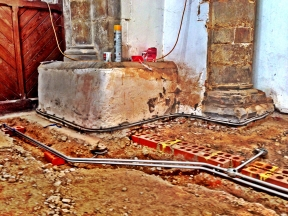 Some of the brickwork needs cutting out to fit the conduit.