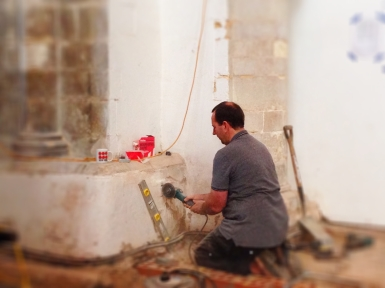 Jim, to the left of the entrance to the parish room, cutting out a hole to site one of several sockets.