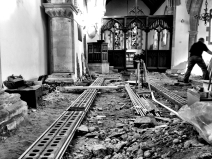 Conduit running down the length of wall one towards the pulpit.