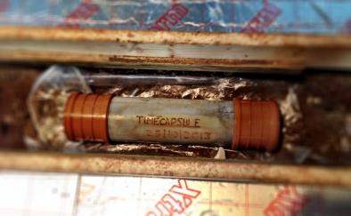 Timecapsule in situ between floor joists.