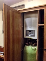 Bolier and water tank snuggly fitting in the Parish Room cupboard.