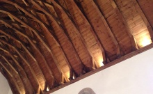 Uplighters in the Chancel show the woodwork to its best.
